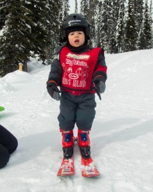 Little boy wearing ski outfit - Learning to Ski at Kelowna's Big White