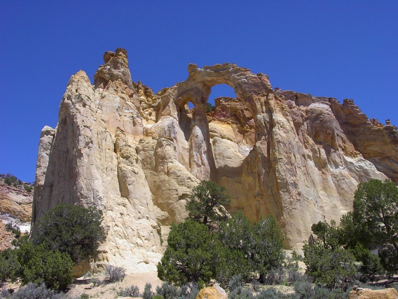 An arch high up in beige cliffs in Grande Escalante National Monument, Utah - things to see in the American Southwest