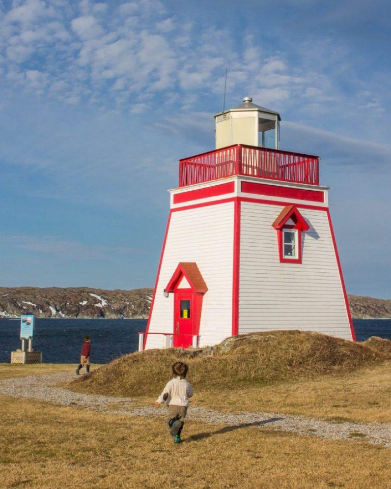 Fox Point Lighthouse with 2 children running around it.
