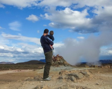 A father and son look at a steam vent in Iceland - An Epic 14 Day Iceland Itinerary