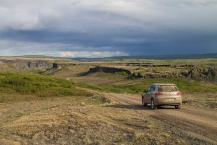 An SUV drives along a rocky back road in Iceland - An Epic 14 Day Iceland Itinerary
