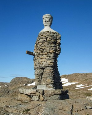 A sculpture or a viking holding a sword in a barren highland of Iceland - An Epic 14 Day Iceland Itinerary
