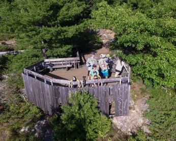 An aerial shot of two families at a cliff overlook - Top things to do in Bon Echo Provincial Park