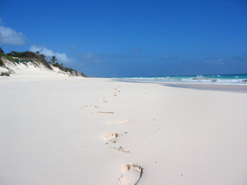 Footprints in the sand at Elbow Bay Beach Bermuda, one of the best Bermuda Beaches