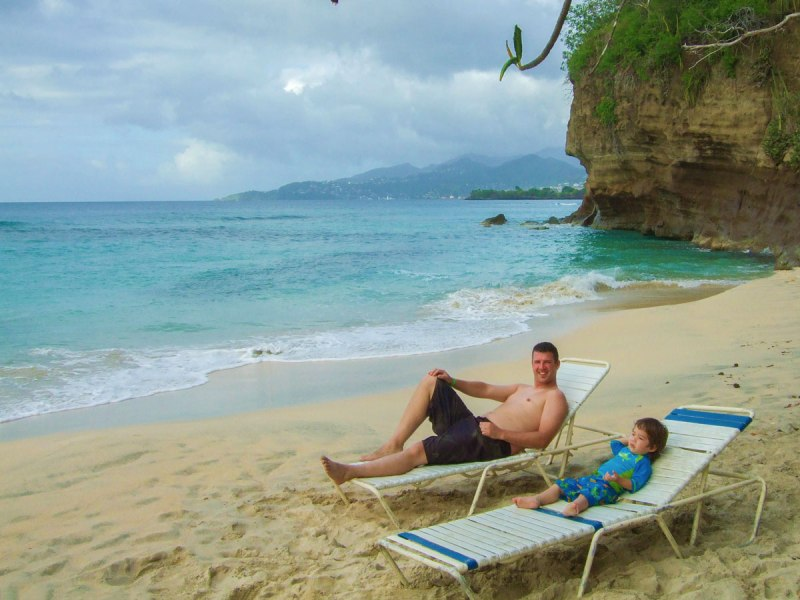Kevin Wagar and his son relax on the beach in Grenada