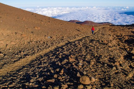 Woman on trail in the Mauna Kea Ice Age Natural Area Reserve.