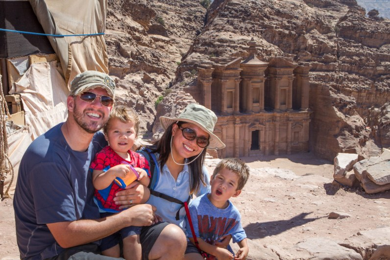 A young family smiling near the Monastery in Petra, Jordan