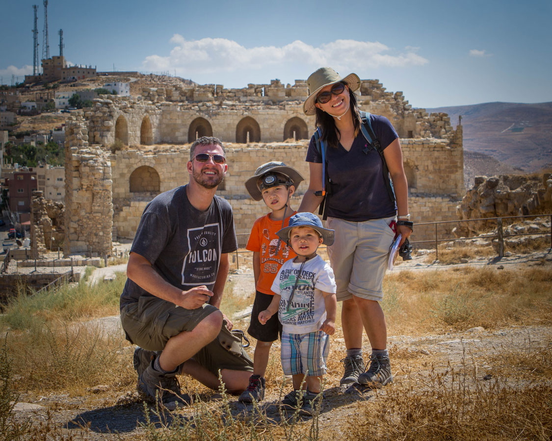 A young family poses for a photo on the top of the Kerak castle in Jordan.
