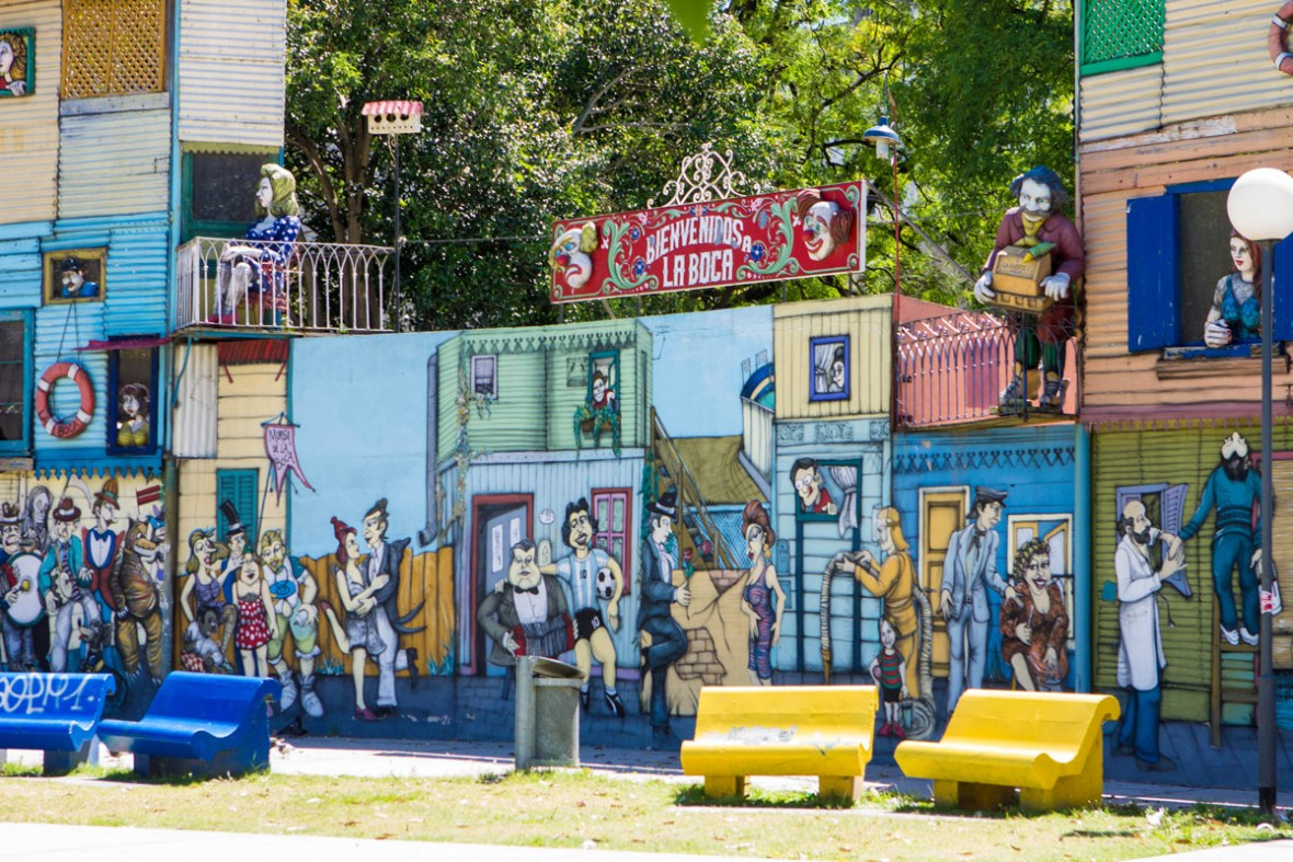 Colorful art welcomes peple at entrance of La Boca, one of our Buenos Aires highlights.