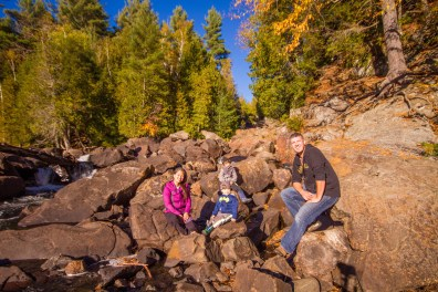 A family poses for a shot taken by a drone dji phantom at ragged falls in the Muskoka region near Huntsville, Ontario