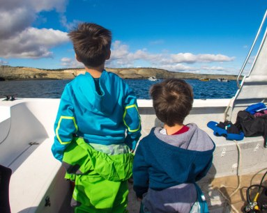 Boys look out onto the sea lion colony at Punta Loma.