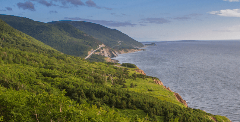 The Cabot Trail winds along the coast of Nova Scotia and is one of our 12 unforgettable Canadian road trips.