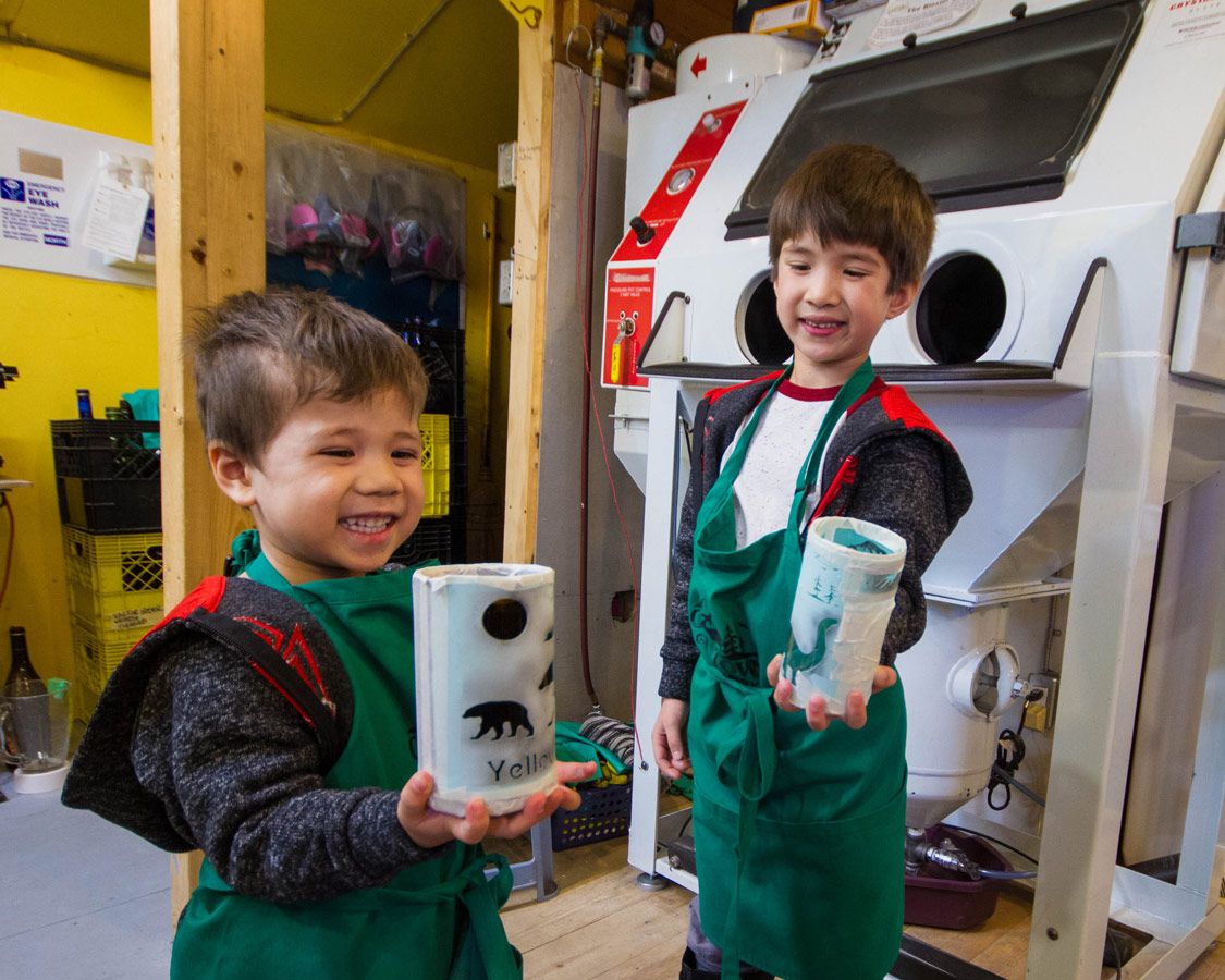 Boys showing off homemade glass.