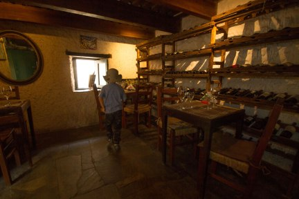 Boy wandering around the cheese racks in Buenos Suspiros in Colonia del Sacramento, Uruguay.