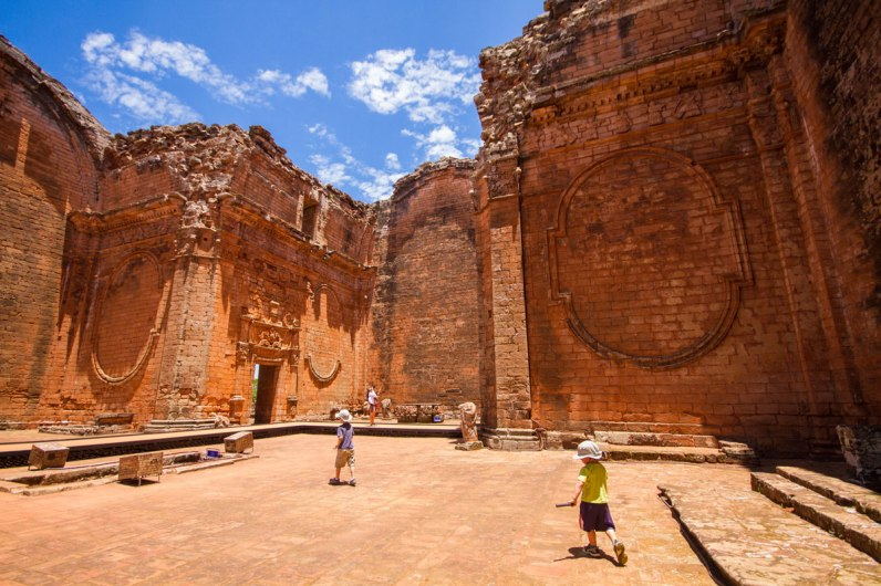 two young boys explore the ruins of the church of Trinidad at the Jesuit ruins in Paraguay