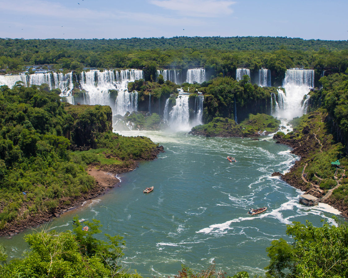 Boat tours heading to the some of the waterfalls in Iguazu falls.