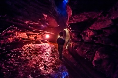 Boy admiring the shadows cast by the lights at Secret Caverns New York, one of the best show caves we have visited.