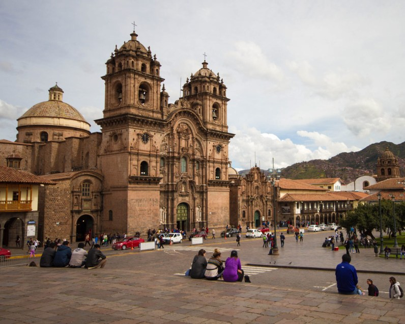 Visiting the Plaza d'Armas is one of the best things to do in Cusco. Locals and tourists alike relax on the stone steps in front of the churches and eat local treats.