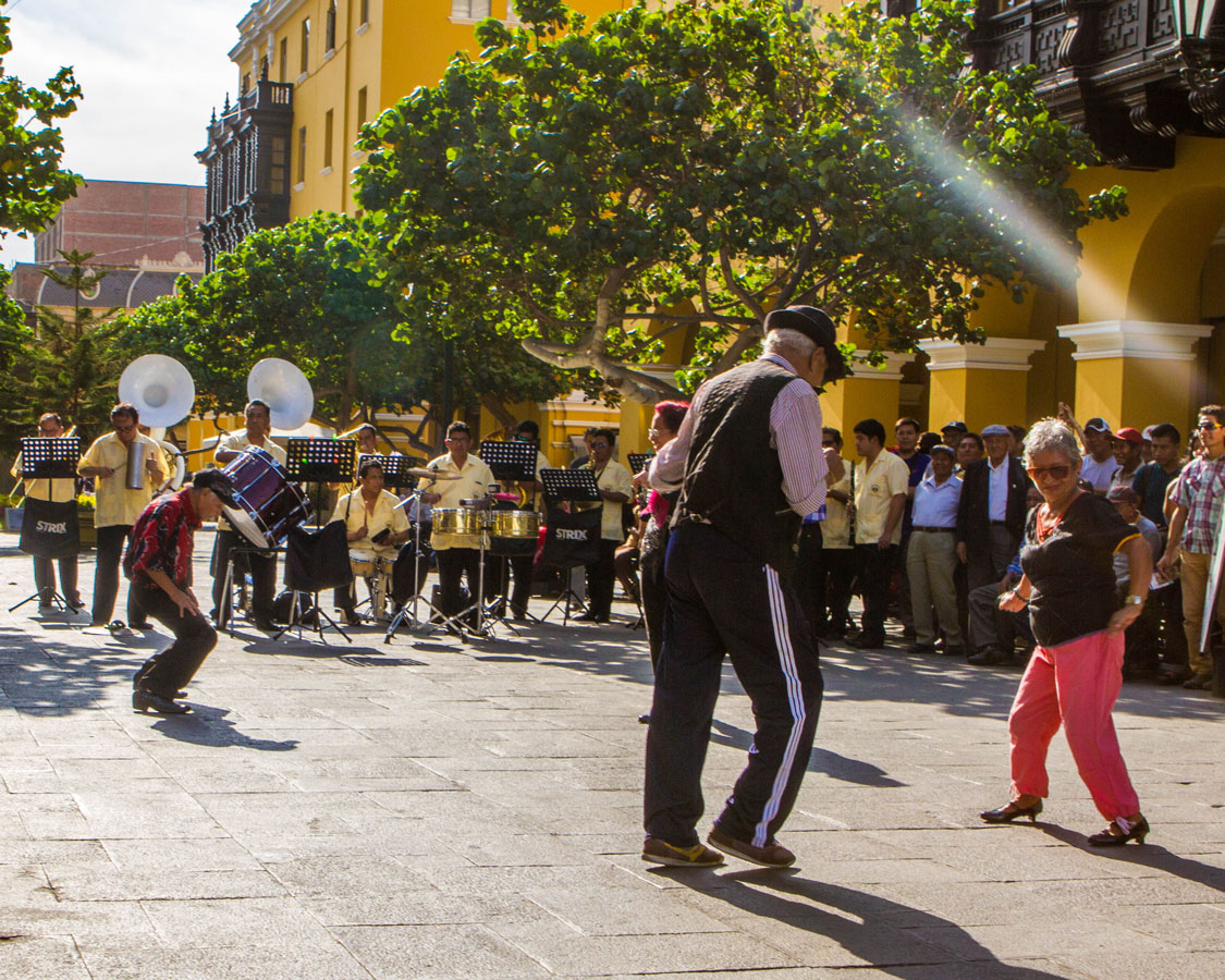Seniors dance to a live band in the streets of Lima Peru was a lot of fun to watch while we traveled in Peru with kisd
