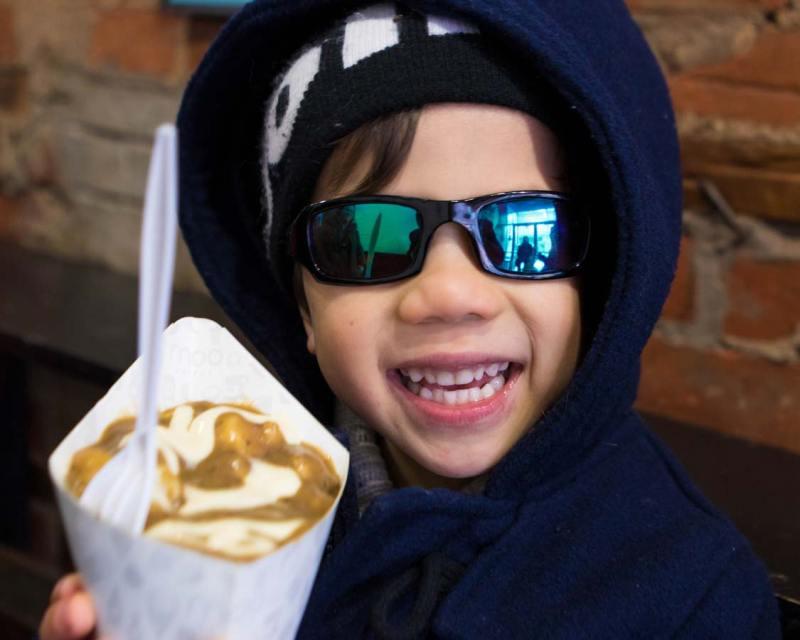 Eating Moo Frites Poutine on a Toronto Food Tour in Kensington Market with Tasty Tours Toronto