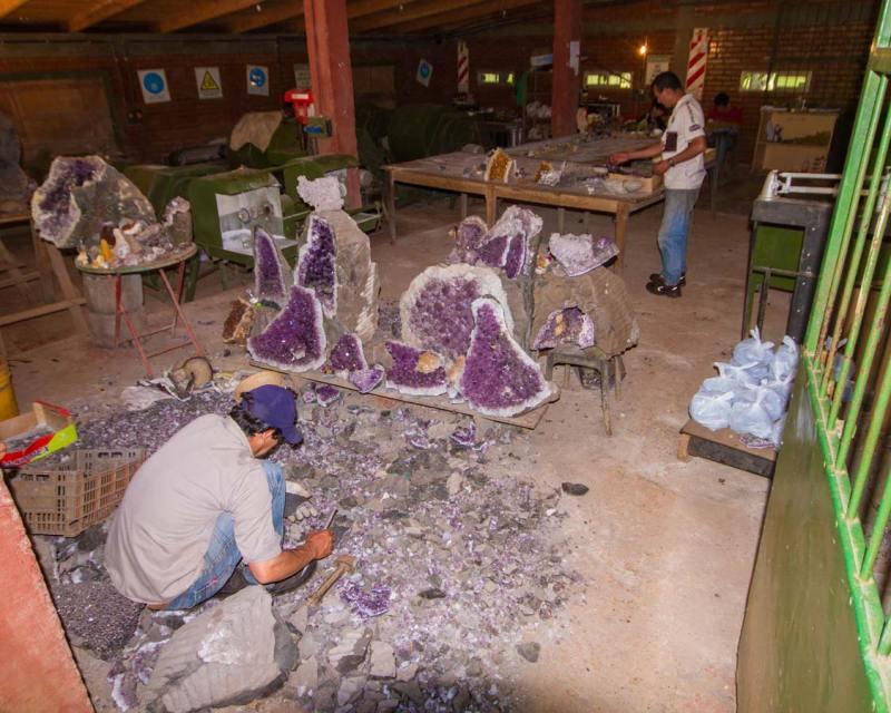 Mineral artists work on geodes mined from Wanda Mines near San Ignacio Argentina