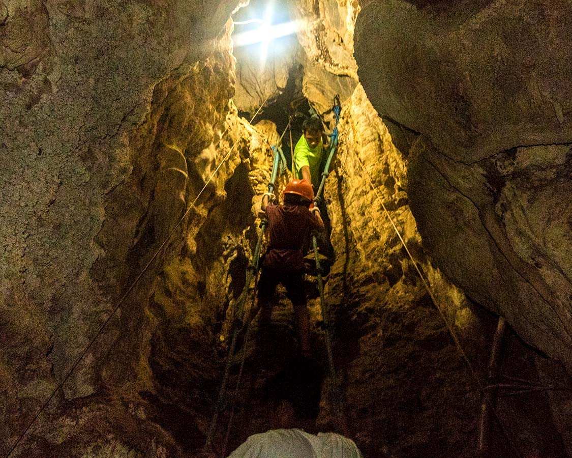 Boy climbing ropes at Ugong Rock in Puerto Princesa Philippines