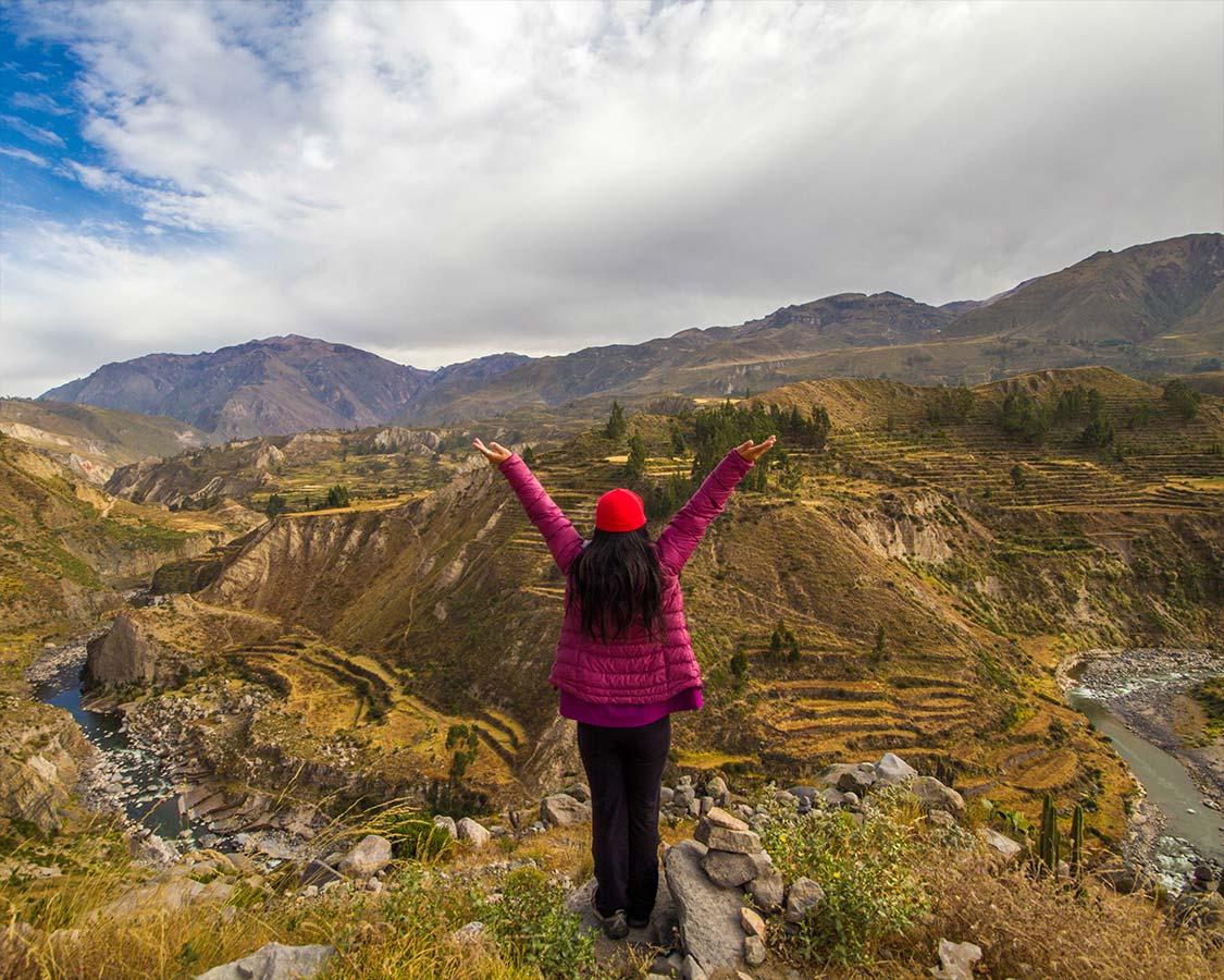 Woman posing in Colca Canyon Peru