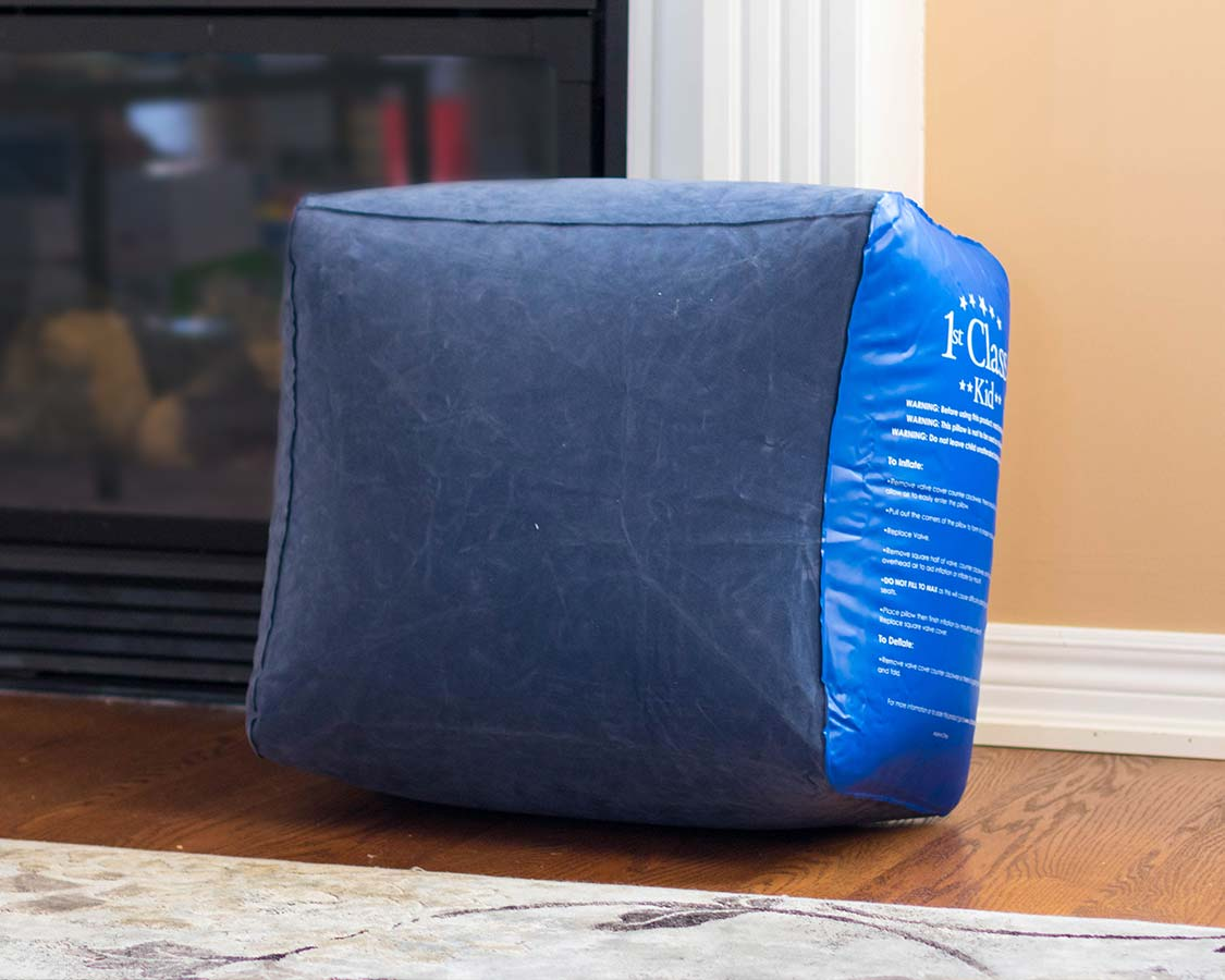 inflated 1st Class Kid Travel Pillow from front travel footrest airplane