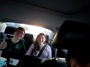 Two kids in the back seat