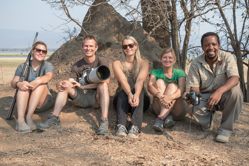 Relaxing with friends Tonya, Colleen, and Fannuel after a morning tracking wild dogs in Mana Pools, Zimbabwe
