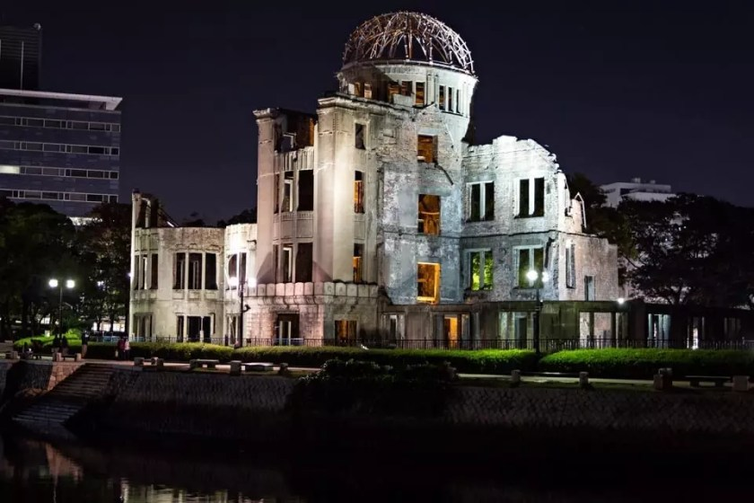 View of the lit Atomic Dome in Hiroshima at night.