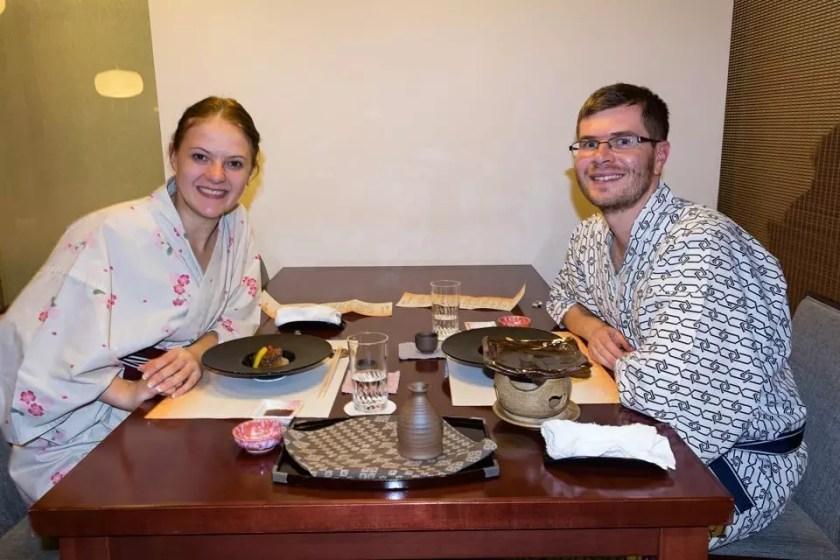A couple enjoying their kaiseki dinner in a traditional Japanese ryokan.