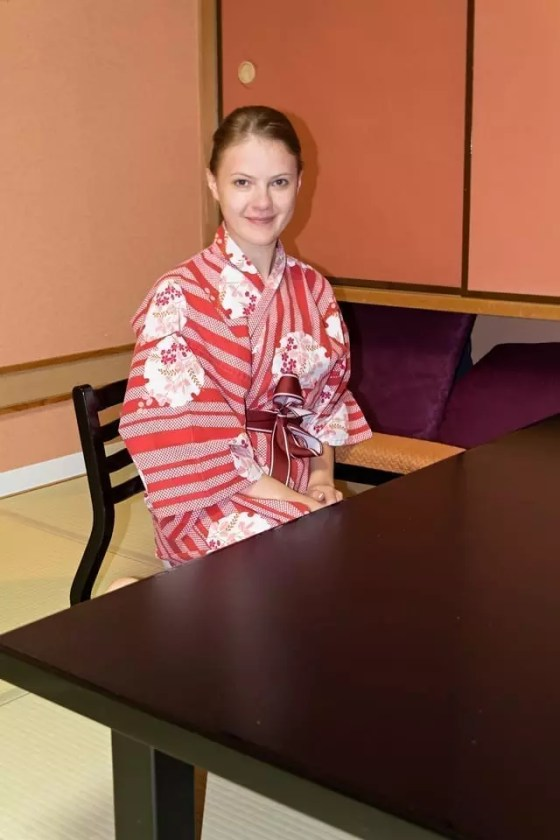 Young lady in traditional ryokan room in Japan.