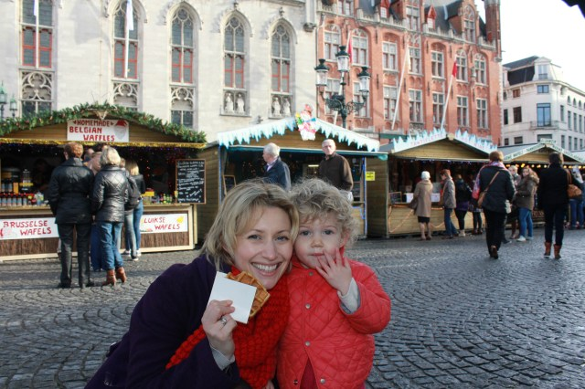 Eating waffles in Bruges