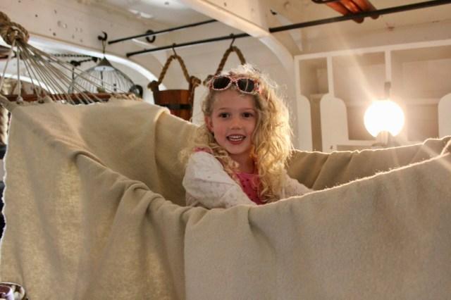 Mrs T in a hammock in HMS Warrior
