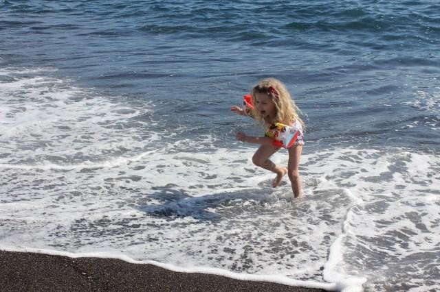 Mrs T at Perissa beach in Santorini