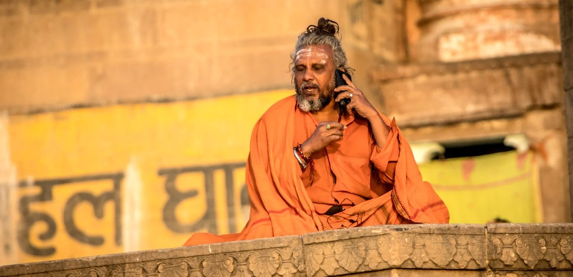 Images of monk on phone in India
