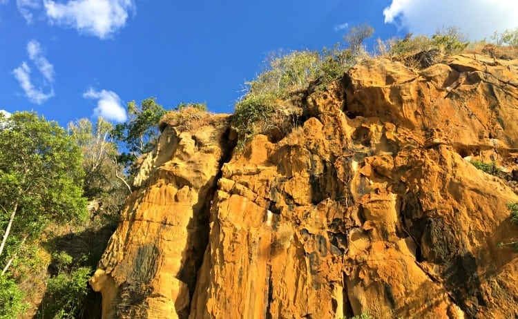 Image of orange cliff edge and blue skies