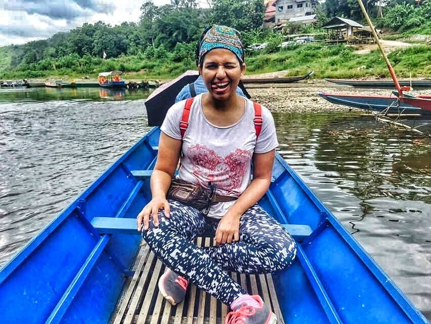 Aditi Shukla in a boat in Lunag Prabang in Laos