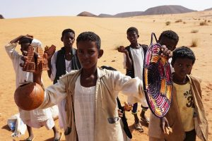 desert boys-selling souvenirs Pyramids of Meroe in Sudan
