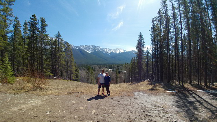 An image of a couple standing on the trail to Troll Falls in Kananaskis, Alberta