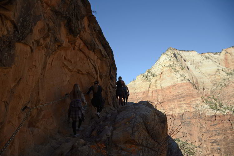 An image of a group of hikers heading up the trail to Hidden Canyon in Zion National Park in Utah - Best Zion National Park Hikes