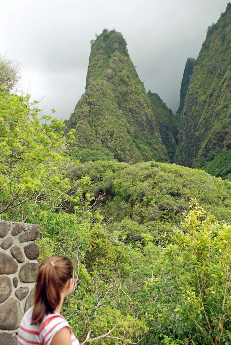 An image of a woman gazing at the 'Iao Needle in ʻĪao Valley State Park on Maui, Hawaii - Hiking Maui