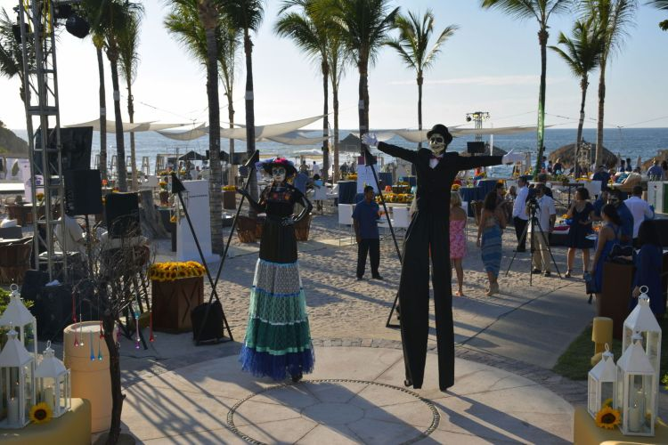 An image of a Day of the Dead party with people dressed in costumes - Day of the Dead Festival -Dia de los Muertos