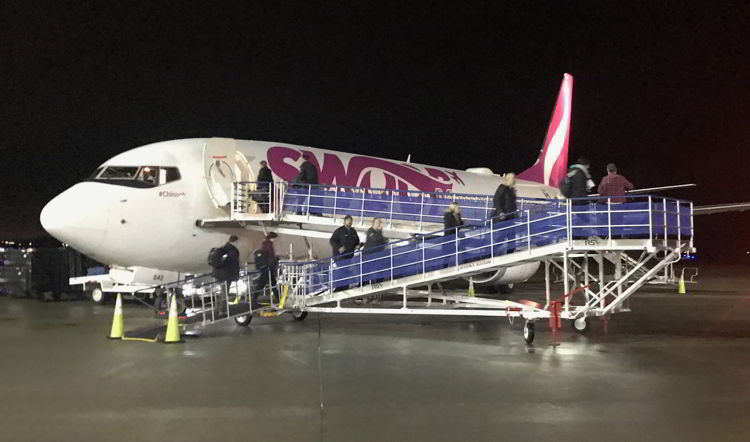 n image of people boarding a Swoop aircraft at Abbotsford airport - Swoop Airlines review
