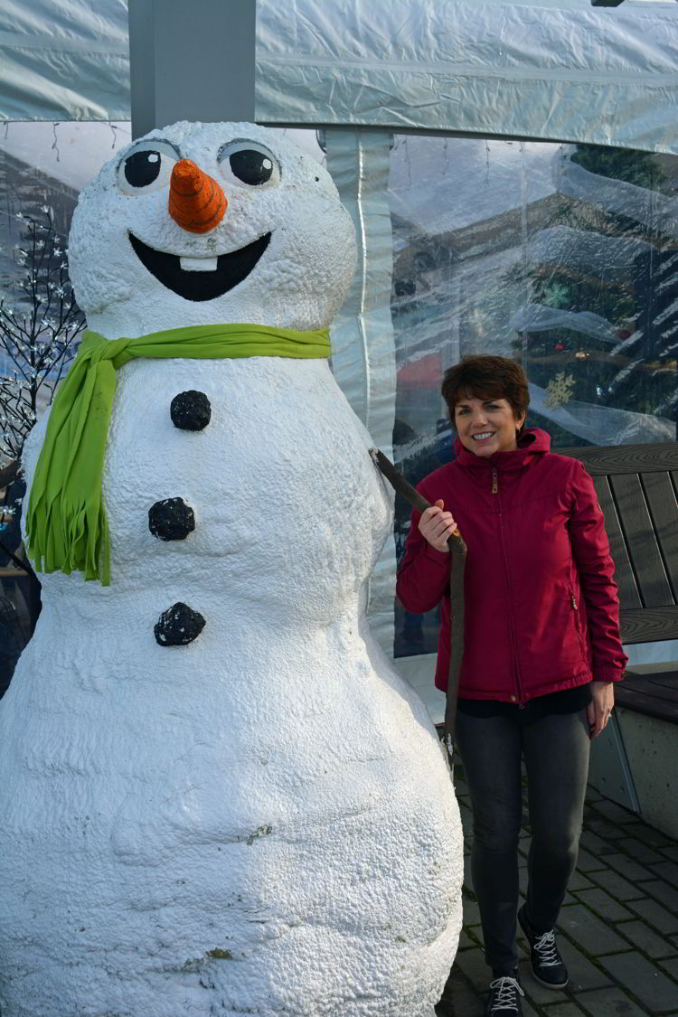 An image of a woman posing with a snowman in Vancouver, BC Canada - Vancouver Christmas lights
