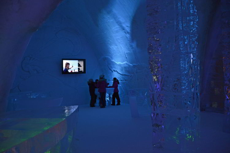 An image of people watching TV in the Hôtel de Glace in Quebec, Canada - Ice Hotel Quebec