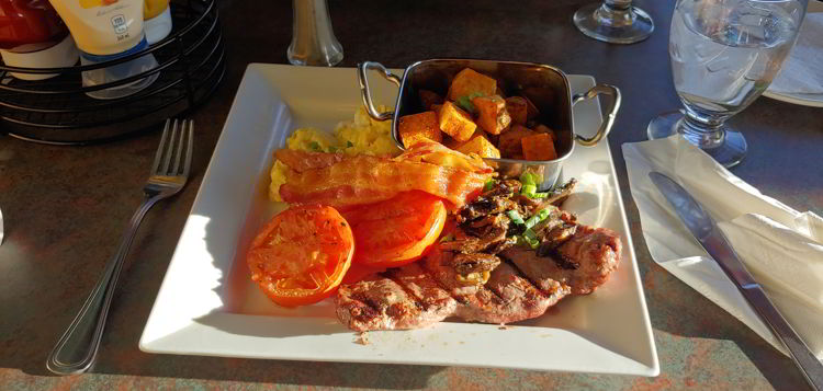 An image of a brunch plate with steak and eggs at the Caribou Chalet at Marmot Basin in Jasper, Alberta - Jasper Skiing