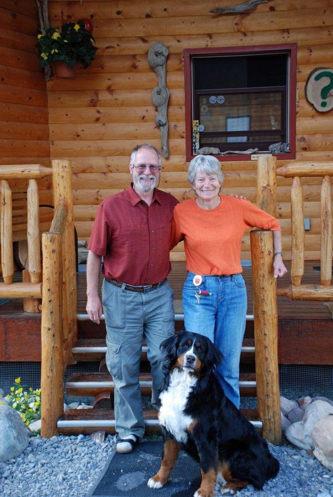An image of Alan and Madeleine Ernst outside Aurum Lodge - Abraham Lake, Alberta