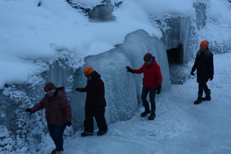 Image of a group of people doing an ice walk in the bottom of Maligne Canyon in Jasper National Park - Avoid the Winter Blues.